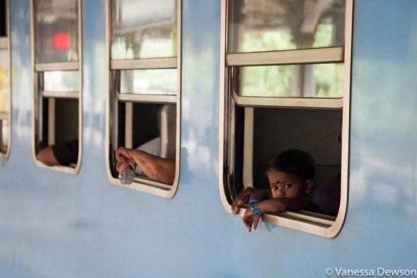 Girl looking out the train window, Kandy, Sri Lanka