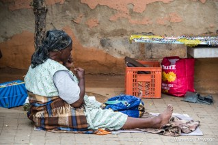Women making and selling beaded crafts