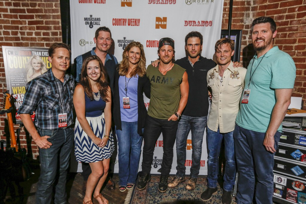 Pictured (L-R): Jeff Meltesen (Country Weekly Publisher), Dana Sones (Musicians On Call Midwest Tour Director), Pete Griffin (Musicians On Call President), Lisa Konicki (Country Weekly Editor-In-Chief), Kip Moore, Chuck Wicks, Frankie Ballard and Jon Freeman (Country Weekly Managing Editor) Credit: Courtesy of Ed Rode, Country Weekly