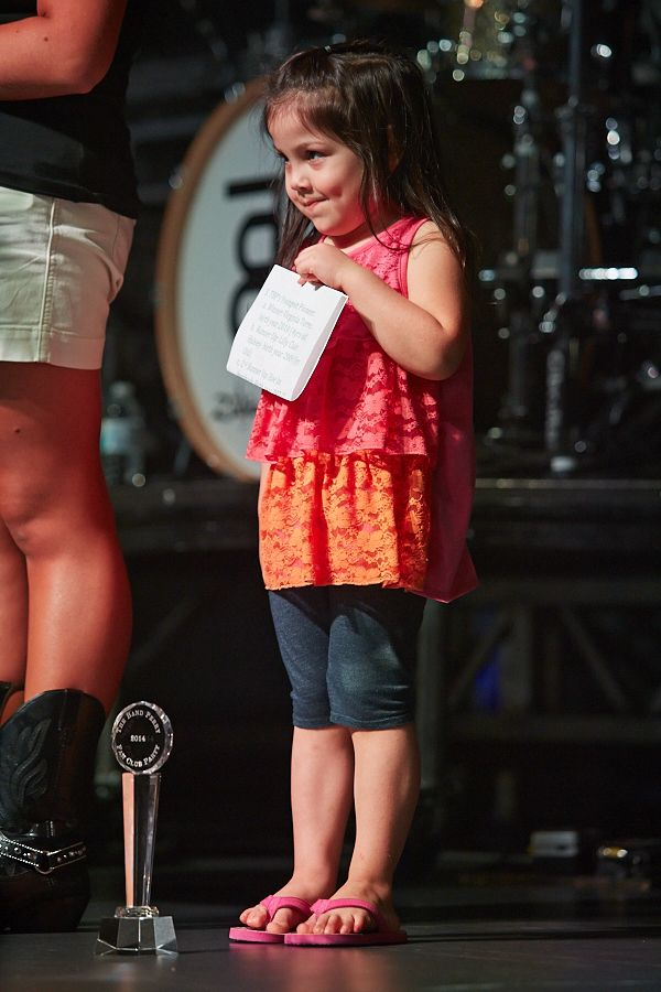 One of The Band Perry's youngest fans receives a special award from the band during fan club party.