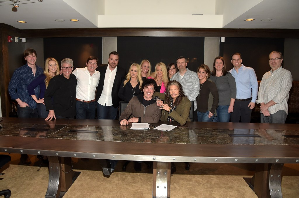 Members of BMLG Staff gather as Steven Tyler signs with Dot Records. Pictured (L-R): Crowd Surf's Read Davis, BMLG's Tali Canterbury, Jimmy Harnen, John Zarling, Kris Lamb, Sandi Spika Borchetta, Laurel Kittleson, Allison Jones, Alicia Matthews, Andrew Kautz, Kelly Rich, Melanie Ainsworth, Jake Basden and Malcolm Mimms.
