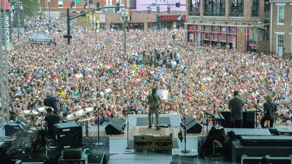 "Keith Urban plays free concert in downtown Nashville to huge crowd to celebrate new album, ""RipCord""."