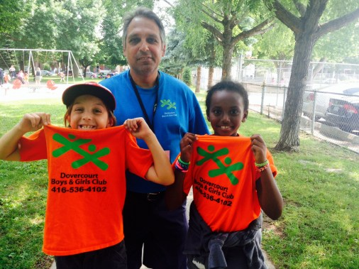 Organization Supervisor proudly poses with campers