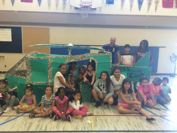 Jason Weatherup, Tyra and campers with the prop helicopter they built.