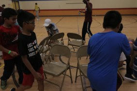 Enjoying a game of musical chairs.