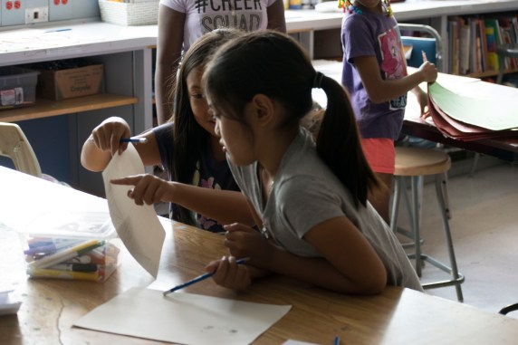 Campers showing each other their artwork