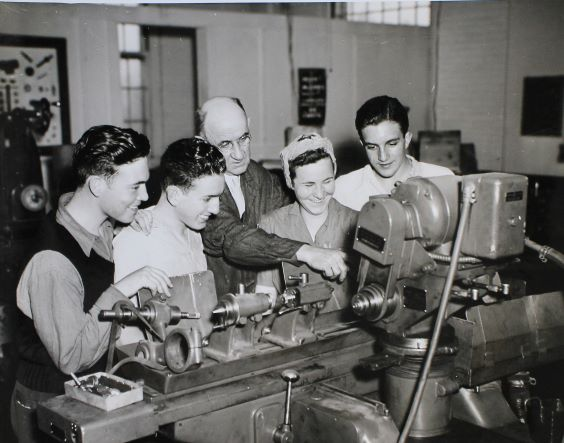 Young Men and Women in a Workshop