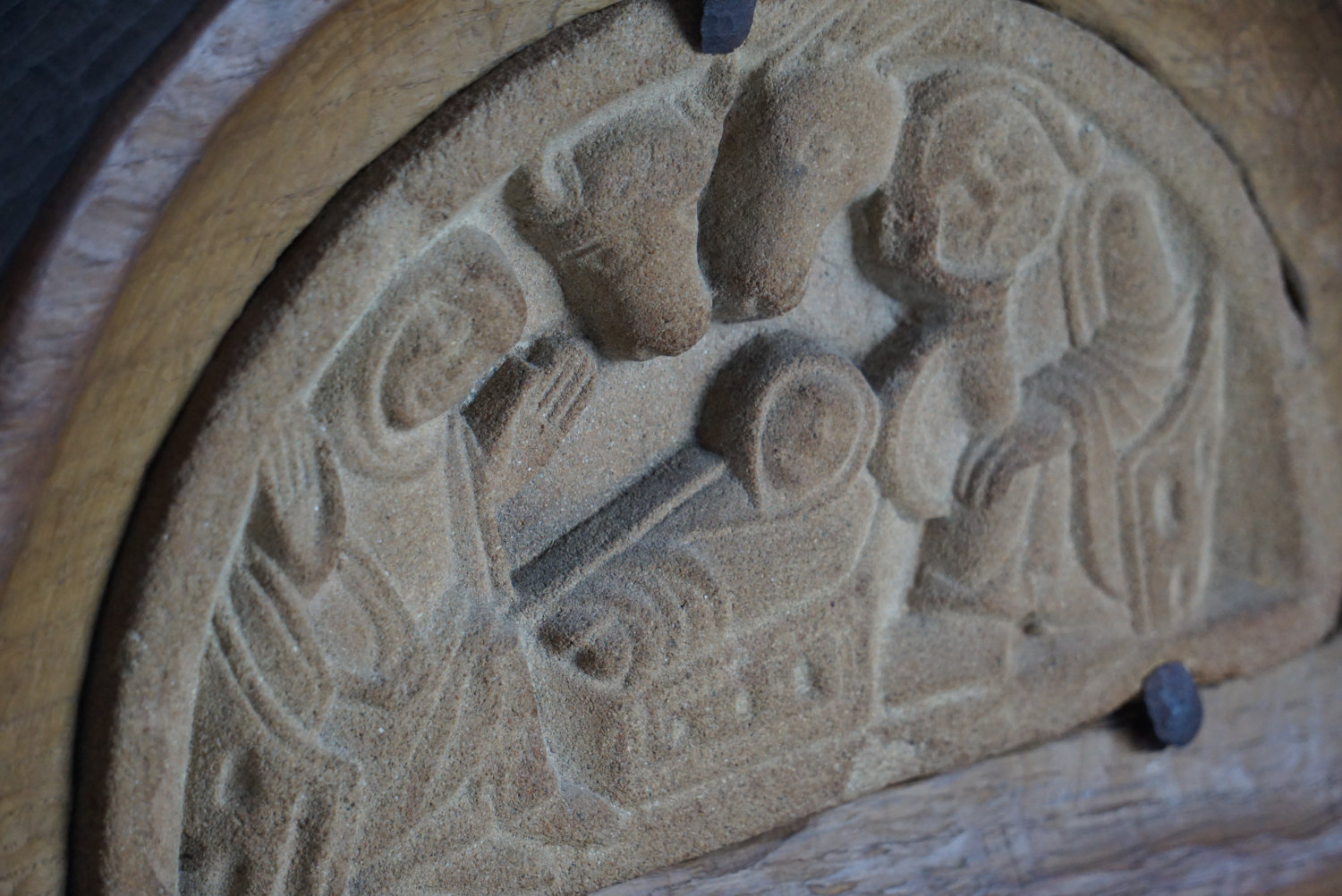 Medieval european limestone nativity carving in hand