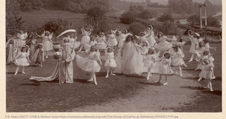 Group of little girls dressed as fairies rehersing for their play.
