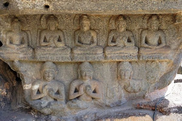 A Stone Carving of 8 sitting Buddhas
