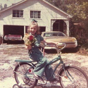 Me learning to ride my first bicycle training wheels and all.
