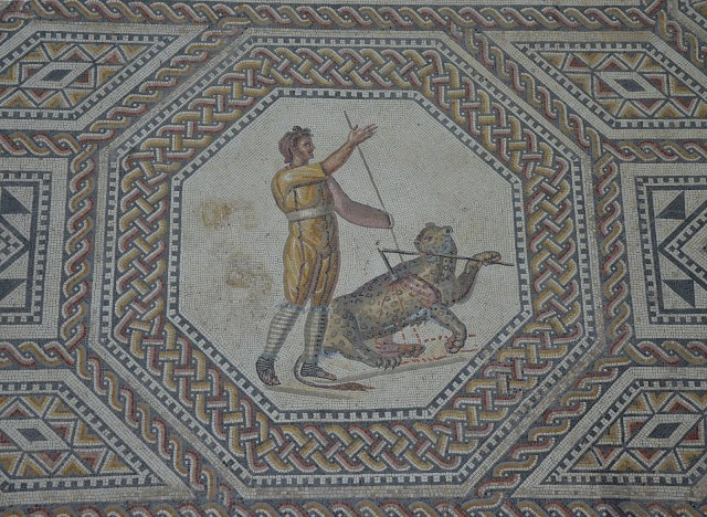 Javelin thrower with panther, the gladiator mosaic at the Roman villa in Nennig, Germany © Carole Raddato