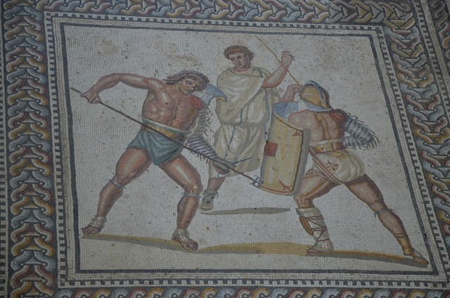 A Retiarus armed with trident and dagger fighting against a Secutor, the gladiator mosaic at the Roman villa in Nennig, Germany © Carole Raddato