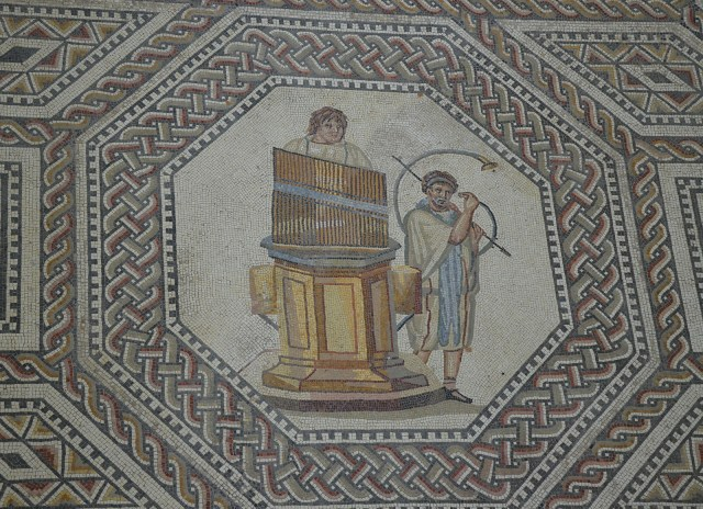 Organist and horn player, the gladiator mosaic at the Roman villa in Nennig, Germany © Carole Raddato