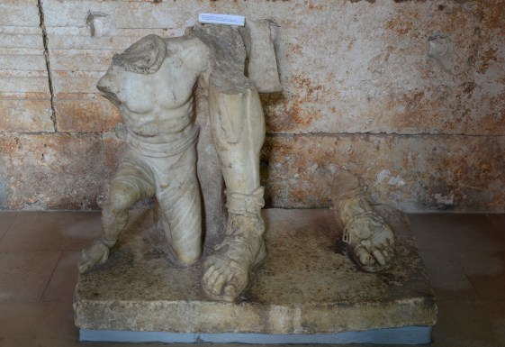 The lower section of an imperial statue, with a Gaulish prisoner or slave in a submissive posture, on display in the Temple of Augustus