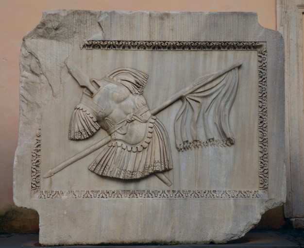 Trophy of arms (armor, lance and flag) relief from the Hadrianeum, a temple of the deified Hadrian in the Campus Martius erected by Antoninus Pius in 145 AD, Capitoline Museum © Carole Raddato
