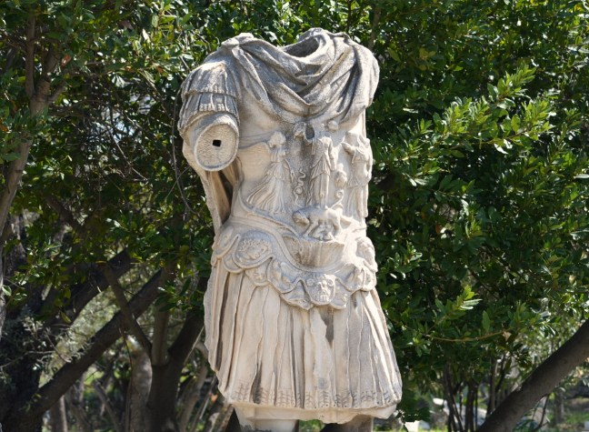 The headless statue of Hadrian stading in the Ancient Agora of Athens.