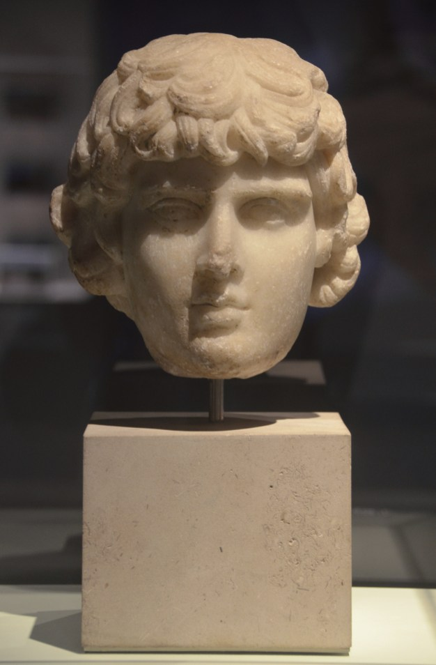 Marble head from a small bust of Antinous, around AD 130, probably from Rome. Now in the British Museum.