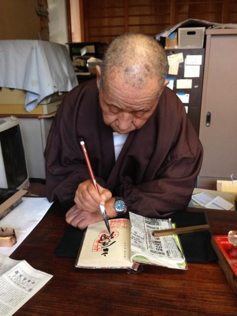 Receiving my stamp at Temple 70, Motoyamaji