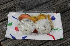 A delicious and filling lunchbox (rice balls, tempura and grilled salmon) from Minshuku Kawarabi-so