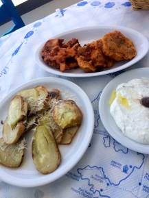 Fried eggplant and a traditional Santorini dish of fried tomato balls which are breaded with onions and peppers inside