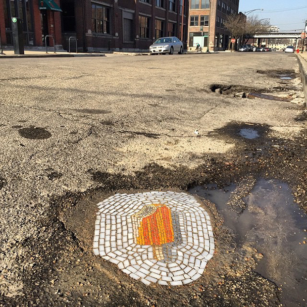 Here's a better look of Creamsicle's new home. It's in an area where nearby restaurants are popular with cabbies. there is a decent chance a taxi will be parked over it during lunch or dinner hours. #bachor #jimbachor #potholeart #potholemosaics #2015potholeartinstallations