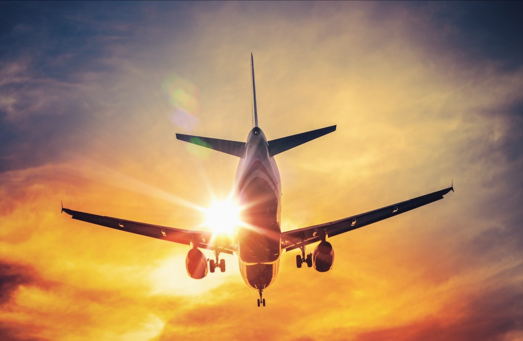 stress free flights tips - sunset and airplane