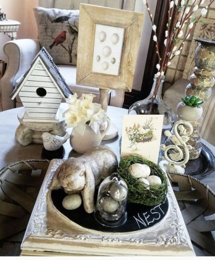 Shabby chic neutral coffee table styled for spring bird nest chippy candle sticks birdhouse spring decorating ideas with bunnies and blooms