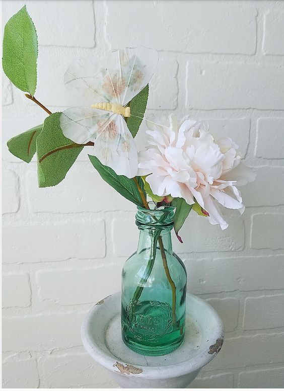 Realistic faux peony in a teal green bottle. Beautiful French Farmhouse style vignette!