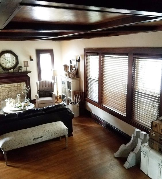 neutral living room with coffered ceiling beams vintage salvage corbels