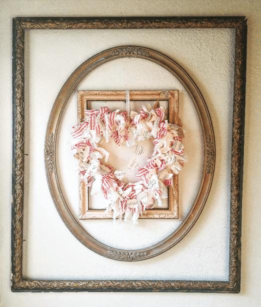 Shabby farmhouse DIY heart rag wreath hanging inside antique picture frames