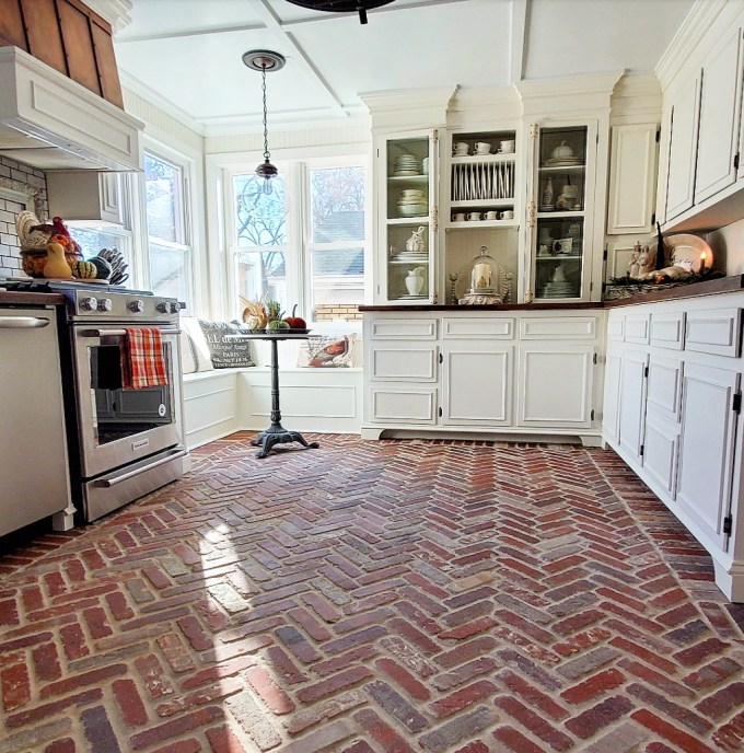Beautiful 1920's kitchen with brick floor, butler's pantry and cremone bolts on glass cabinet doors, faux copper range hood