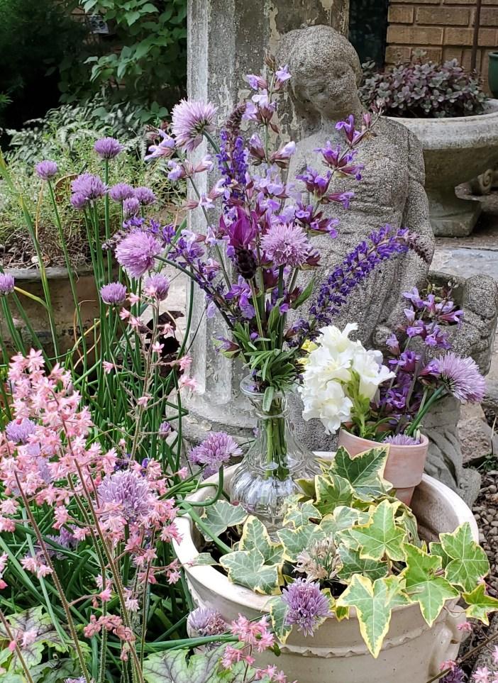 vintage garden ideas cottage garden purple flowers purple plants garden statuary