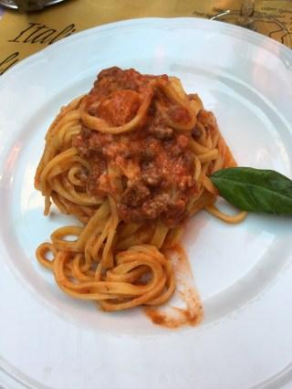 Our Roman artichoke, wine, and spaghetti bolognese