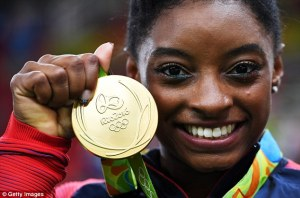 370d8a3500000578-3732340-superstar_simone_biles_poses_with_her_gold_medal_in_rio_on_tuesd-a-6_1470850053414
