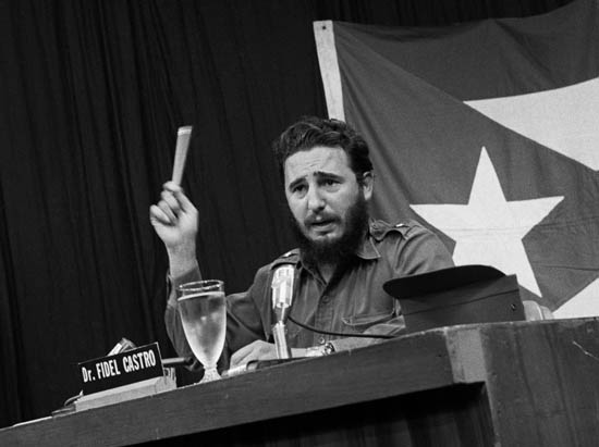 Fidel Castro Gesturing While Speaking at Podium on Reprisals
