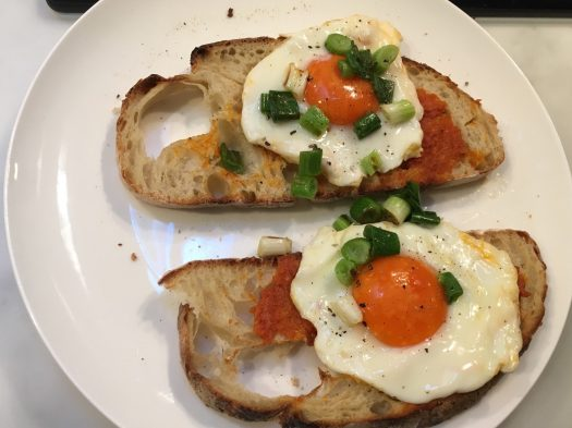 Eggs on sobrasada on toast, with spring onions