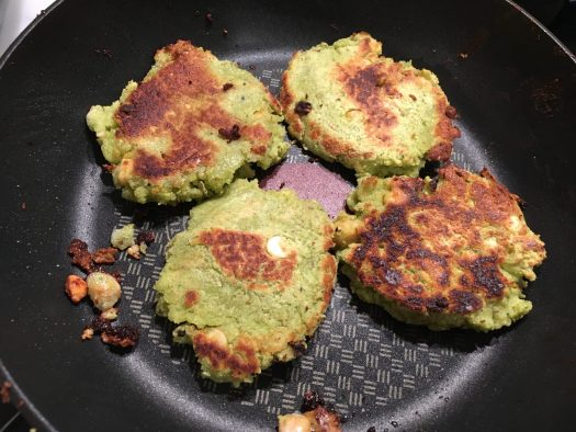 Four falafel fritters, browning