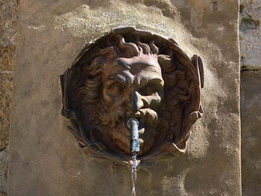 Fountain head looking like a mythological figure