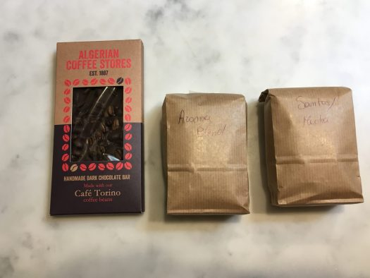 Two bags of coffee and a chocolate bar