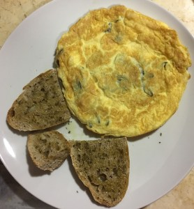Sage and cheese omelette, with toasted sourdough bread