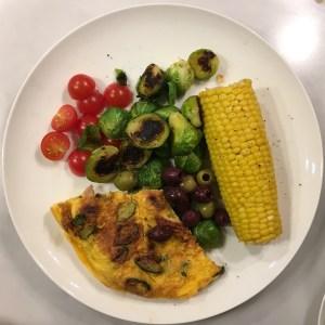 Corn on the cob, omelette, salad