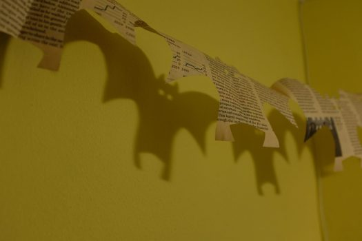 Bat decorations made out of newspaper