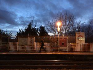 Image of the platform at East Acton tube station, at dusk