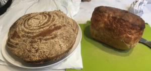Two sourdough loaves, side by side