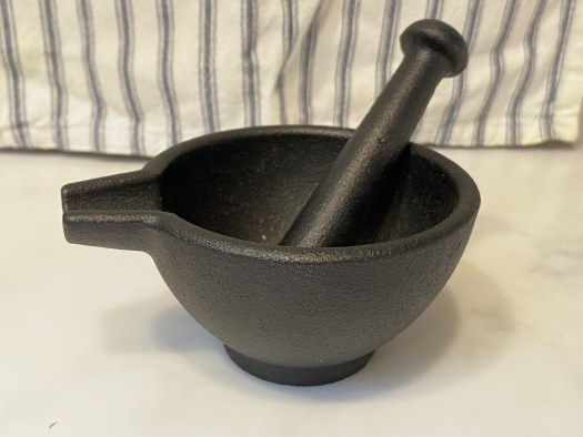Hand-held cast iron mortar and pestle
