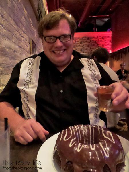 Jake with his cake and whiskey from Werewolf in San Diego, CA