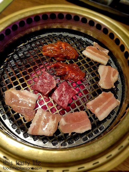 Meats grilling on the hot grill | Gyu-Kaku Japanese BBQ - Scripps Ranch / San Diego, CA