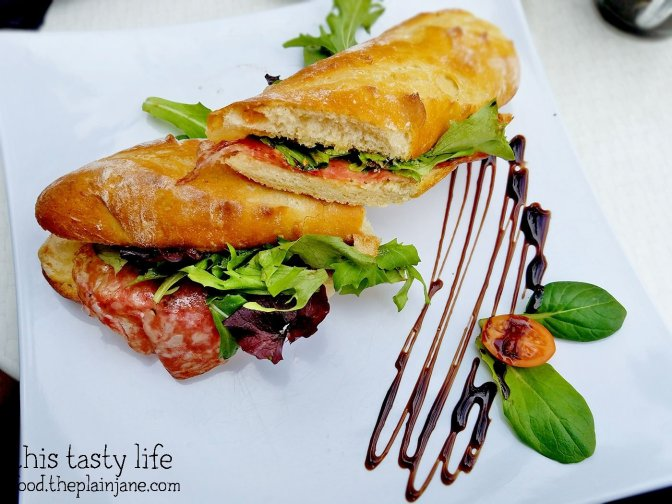 Corse Sandwich with Salami, Fig Chutney, and Gruyere Cheese at Le Parfait Paris | San Diego, CA