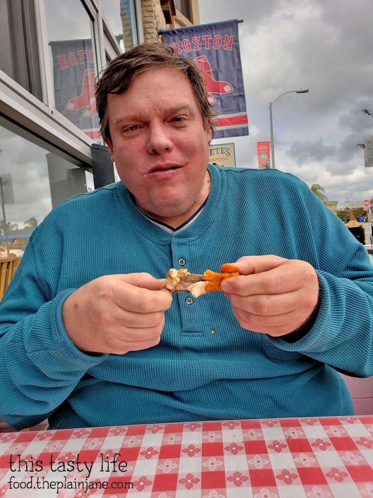 Jake eating wings at Pete's Seafood - North Park - San Diego, CA